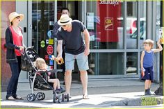 Vera Farmiga and her husband Renn Hawkey take their kids Gytta and Fynn for a stroll on July 18, 2013