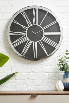 Buy XL Roman Numeral Wall Clock from the Next UK online shop Chrome Wall Clock, Glass Candlesticks, Roman Numerals, House Prices, Home Lighting, Table Centerpieces, Event Decor, New Kitchen, Pillar Candles