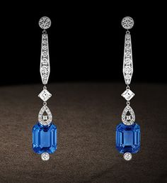 Earrings in white gold paved with diamonds and set with two cushion-cut sapphires. Chaumet, Paris