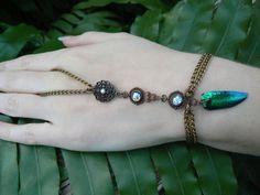 victorian slave bracelet jewel beetle vintage amethyst glass rhinestone victorian gypsy boho fantasy gothic and fantasy style. $30.00, via Etsy.