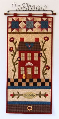 Love the row of stars across the top! Quilted wall hanging