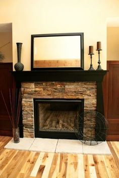 Black is dramatic and dressy. It can turn a modern fireplace into ultramodern. And it can also look great when used with rustic elements like this ledge stone. It pulls out the deep undertones in the stones beautifully.