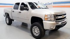 Silver Quad-cab 2011 Chevrolet Silverado 1500 LT, Z71 4x4, V8 Automatic 4 wheel drive, flex fuel  Visit http://www.SouthCoastAutos.com  Used truck for sale in Houston, Texas 77008, Northwest Fwy 77065 77095, Jersey Village 77040, Cypress 77429, Fry Rd 77433, Waller 77484