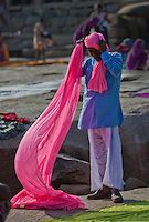 A pilgrim wearing his Pagree on the bank of Tungabhadra River at Hampi.