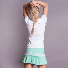 Soft microfiber -mesh cap sleeve, tennis top with green piping detail. Made in USA. SHOP Activewear http://www.denisecronwall.com/#!product/prd13/2521066851/calypso-cap-sleeve-top