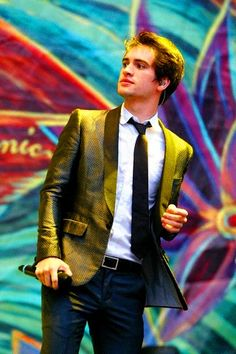 Brendon Urie does his concerts in suits. I'm pretty sure this man is everything