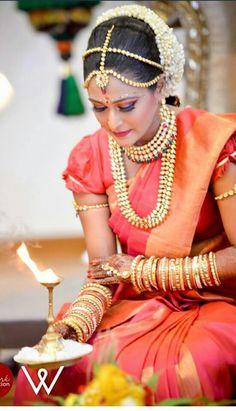 www.sameepam.com  South Indian bride. Temple jewelry. Jhumkis.Red silk kanchipuram sari.Braid with fresh jasmine flowers. Tamil bride. Telugu bride. Kannada bride. Hindu bride.Malayalee bride.Kerala bride.South Indian wedding.