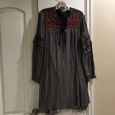 Sale! Free People Embroidered Peasant Dress Lovely Free People embroidered lace up peasant dress. Fully lined with built in pockets. Oversized loose silhouette. Pre-loved in good condition. Free People Dresses