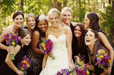 A perfect picture of a bride and her bridesmaids - everyone is laughing and smiling!