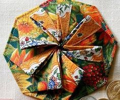This video tutorial will show you how to make an origami Tato pleated coin purse. This purse can also be made out of fabric by stitching the corners. ...