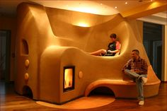 Rocket stove heater in a cob house. Cob Building, Building A House, Green Building, Rocket Mass Heater, Earthship Home, Stove Heater, Natural Homes, Earth Homes, Rocket Stoves