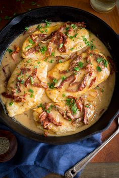 Chicken and Sun-Dried Tomatoes in Creamy Madeira Sauce - pan-fried chicken breasts served in an amazing creamy Madeira wine sauce (with no cream). | tamingofthespoon.com