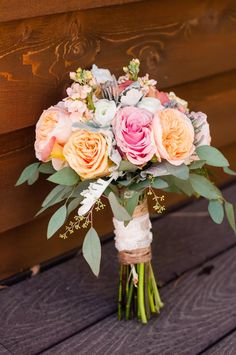 White Mountain Wonder | Simply Beautiful Weddings  Events. Bouquets: garden roses, gerbera daisies and ranunculus.