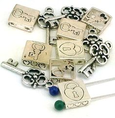 12 lock and key 2 hole silver 2 hole slider beads B160