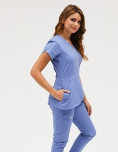The Tulip Top in Ceil Blue is a contemporary addition to women& medical scrub outfits. Shop Jaanuu for scrubs, lab coats and other medical apparel. Scrubs Outfit, Scrubs Uniform, Medical Uniforms, Work Uniforms, Stylish Scrubs, Lab Coats, Tulip Sleeve, Womens Scrubs, Medical Scrubs