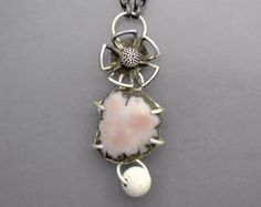 A sterling silver necklace with a gorgeous polished agate stalactite slice and three natural drusy cabochons. Natural and beautiful. Necklace chain length is 20. The pendant hangs down 2 - 1/2 and the slice is 5/8 in diameter.  .