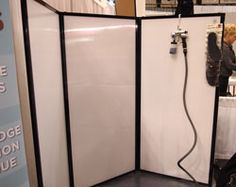 This Spray Tan Salon uses Versare's Privacy Screen with opal polycarbonate panels for easy-cleanup after spray-tanning sessions.