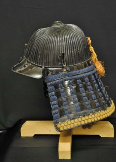 Kuro urushi (black lacquer), 86 ken (86 plates), tetsu (iron), suji bachi (expose raised ribs) kabuto (helmet) with wakidate (side crest) Momoyama period (1573–1615).