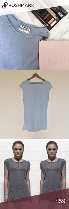 """One Teaspoon Top One Teaspoon Tank   The SOHO Wool Blend Tank features a relaxed fit tank with a scoop neck cut from a super soft sheer wool blend.   • Wide {Pit to Pit}: 20 1/2""""  • Long: 29""""  • Colors: Light Blue   • Relaxed fit  • Sleeveless  • Raw hem  • Sheer body  • NWT   Fabrics:  • 70% Viscose   • 20% Nylon   • 10% Wool  {Last picture shows same tank modeled in a different color.  ✏️Measurements are approximate  💰Bundle Discounts Available 🏷Reasonable Offers Welcomed  ❌Sorry No…"""