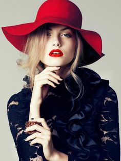 Crimson hat, crimson lips.