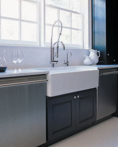 Darryl Carter's renovation of his parents' kitchen : A fireclay farmhouse sink (Shaws Original from Rohl) provides old-world charm amid the stainless steel Viking and Thermador appliances. Fireclay Farmhouse Sink, Fireclay Sink, Farmhouse Sink Kitchen, Kitchen Sink, Farm Sink, Updated Kitchen, New Kitchen, Shaws Sinks, Kitchen And Bath Design