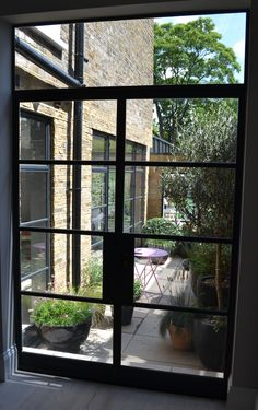 Crittall steel doors with a view to courtyard and additional Crittall steel door. Crittall steel doors with a view to courtyard and additional Crittall steel door screens and windows by Light French Doors Bedroom, French Doors Patio, Terrazzo, Kitchen Patio Doors, Crittal Doors, Crittall, French Windows, External Doors, Aluminium Doors