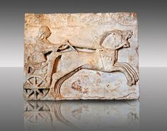 Late  Greek Archaic relief sculpture in Proconnesian Marble of a charioteer ( Last quarter 6th Cent. B.C) From Cyzicus, ( Erdek formerly Artàke, Αρτάκη in Greek) on the southern shore of the sea of Marmara, Turkey.