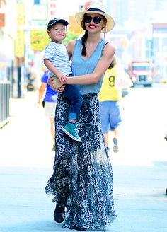 Miranda Kerr (toting son Flynn in NYC June 18, 2013) wore an Isabel Marant skirt, shirt and shoes, along with Stella McCartney sunglasses.