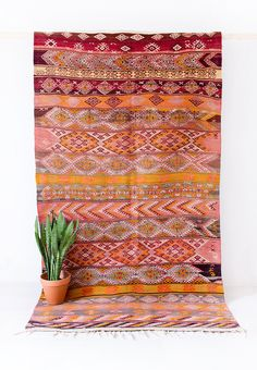 VINTAGE TURKISH KILIM RUG // THE DYLAN  using techniques passed down from generation to generation, this vintage kilim rug was woven using hand-spun wool in the anatolia region of turkey. our one-of-a-kind kilim rugs are around 30 to 40 years old, and were traditionally created as a form of self-expression and art. the geometric motif, nazar (evil eye), is woven throughout the piece and is said to provide protection.  - durable, low profile weave - fringe on one end, woven on the o...