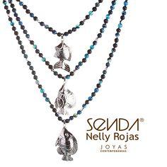 Collar inspirado en la riqueza del mar, está compuesto por cuentas de lapislázuli y peces elaborados en plata. http://www.elretirobogota.com/esp/?dt_portfolio=senda
