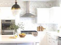 kitchen backsplash to ceiling - Google Search Brass Kitchen, Kitchen Backsplash, New Kitchen, Kitchen Cabinets, Kitchen Ideas, Ceiling Design, New Homes, Ceiling Lights, Interior Design