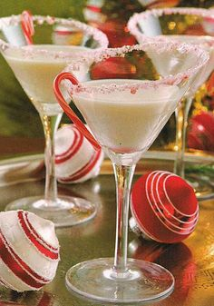 ~PEPPERMINT BARK MARTINI~ Ingredients: 1 oz Vanilla Vodka, 1 oz Godiva White Chocolate Liquor, ½ oz White Crème De Menthe Peppermint Liquor, splash of heavy whipping cream, mini candy canes and crushed peppermint bark for garnish on rim of glasses. Chill martini glasses by filling with ice. Fill your cocktail shaker with ice. Add all ingredients and shake until really cold.
