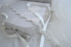 Delicate scallop edge beaded bridal sash will compliment your wedding ensemble with subtle glamour.