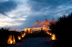 Fabulous use of pillar candles in gorgoeus lanterns create a spectacular walkway ~ gorgeous beachside Sperry tent #wedding