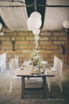 This Grey and White Farm Wedding with babys breath, a lace gown with a keyhole back and a barn reception by Maryke Albertyn Photography is beautiful!