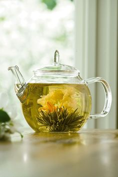"""Blooming Tea Set for joseph: A Bouquet of Tea Blooms in Your Teapot    A surprising and delightful gift for tea drinkers and gardeners alike!  Tea balls """"bloom"""" into beautiful flowers as they steep into a fragrant tea  Set includes a 24-oz. glass teapot with stainless steel strainer, 8 different tea balls and 2 sachets of loose tea"""