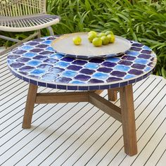 Add a little art to your space with the Mosaic Tiled Coffee Table. Its many ceramic tiles are carefully inlaid by hand onto an FSC®-certified hardwood base, for a unique look both indoors and out.