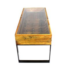 These glass top coffee tables are recreated from original printer's trays making ideal display cases for your small collectibles. Used by letterpress printers in the 1800s, printer's trays are flat wooden boxes divided into a number of small compartments which were once assigned to specific letters, numbers, and symbols. The original printer's tray, along with …