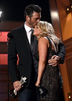 Love them! Blake Shelton kissed Miranda Lambert while they accepted the song of the year award.