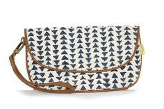 Our new Piped Clutch is wide without being too big. What? Comfortable to carry, it will easily hold your phone, a wallet and all your important items. And the piping gives it the perfect form. It comes with a detachable wristlet giving you another choice to carry this awesome clutch. Specifications: Handspun, handwoven and hand block-printed cotton fabric on the exterior with faux leather piping around the edges. Interior zipper pocket, along with partitions to hold cards.Detachable…
