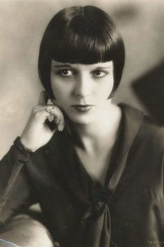 """There's nothing quiet about this silent movie starlet's looks, right down to her """"Dutch Boy"""" bob cut. Her thick thatch of bangs, cut straight across the forehead, became a popular look with flappers seeking to defy society's vision of beauty. via StyleList"""