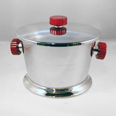 "Glo Hill Chrome and Bakelite Ice Bucket  6 3/4"" high x 6"" wide  This small sized ice bucket by Glo Hill features red marbleized Bakelite han..."