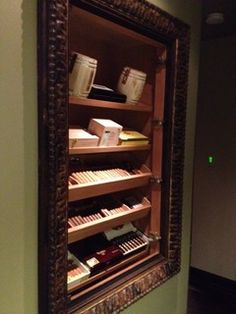 Recessed Wall Humidor. I like putting a classy picture frame around the humidor.
