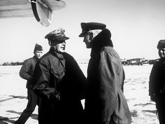 Major General Earle F. Partridge, commanding general of the Fifth Air Force, greeting General of the Army Douglas MacArthur upon his arrival at an advanced AB in Korea.
