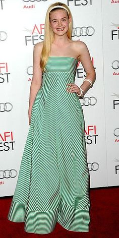 At the same Hollywood screening, the actress goes girlie in a green striped Oscar de la Renta gown, a white headband and matching bangles.