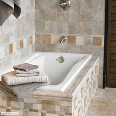 Floor features Montreaux 13 x 13 in color Gris. Montreaux 6 x 6 in color Gris covers the wall with the 4 x 4 in colors Blanc, Brun, and Gris used as a decorative border. Montreaux 6 x 6 in color Gris with the 6.5 x 16 Random Border Mosaic is used to cover the tub walls. The corner of the tub is covered using the 2.25 x 6 Gris Torello V-Cap. From South Cypress. #Bathroom #Design #Inspiration