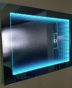 Infinity Mirror H600mm x W800mm (H23 5/8 inches x W31 ½ inches) with sensor switch. Color shown orange.