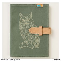 """Animated Owl Journal, Canvas Journal Document your next adventure with our canvas travel journal, handmade in Kenya and decorated in San Jose, California. Featuring a diagonal pocket on one side that's perfect for your iPad mini or city guide, and a full-size pocket--perfect for your notebook journal. Interior loop detail ensures you're never without a pen to jot down directions, and a sliding tongue closure keeps your precious cargo in place.  Dimensions: 6.5""""w x 8.75""""h; left pocket…"""
