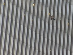 9/11 ~ A man jumps or is blasted from the upper floors of the burning North Tower of New York's World Trade Center