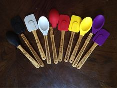 Silicone Spoon and Spatula set. Silicone tops are removable and dishwasher safe. Recommended to hand wash the handles. Handles are burned by hand with a Wand on one side (with Mischief Managed hidden under the silicone top), and Swish & Flick on the other side. Each is approximately